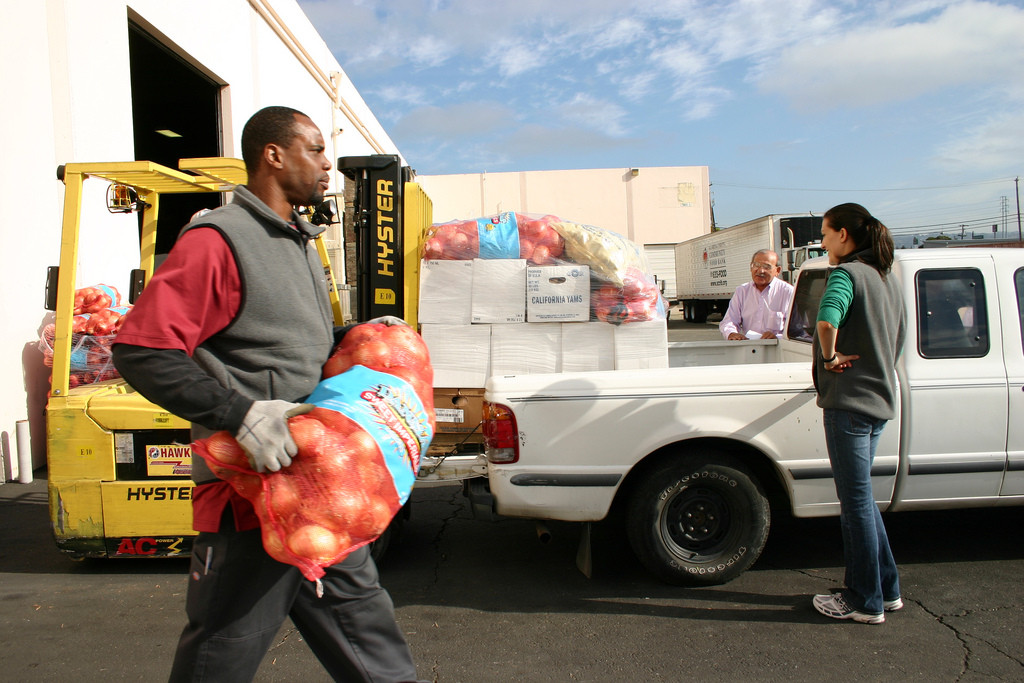Carrying fruit at a food bank