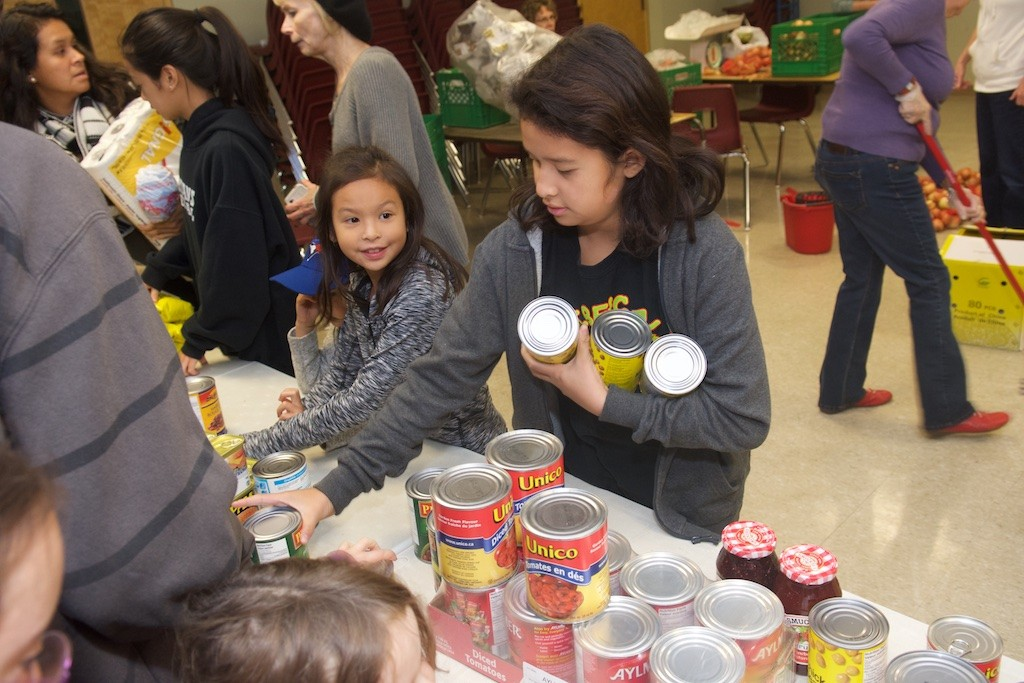 Children from the Toronto East Homeschoolers help sort their food donations.